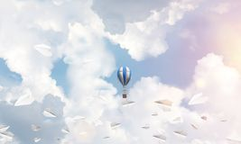 Flying hot air balloon in the air. stock images