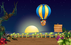 A flying hot air balloon in the middle of the night Stock Image