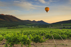 Flying hot air balloon over the mountains Stock Photo