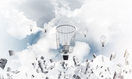 Flying hot air balloons in the air. Colorful aerostats flying among paper documents and over the blue cloudy sky. 3D rendering Stock Image