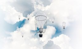 Flying hot air balloons in the air. Colorful aerostats flying over the blue cloudy sky. 3D rendering Royalty Free Stock Photo