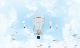 Flying hot air balloons in the air. Colorful aerostats flying among paper planes and over the blue cloudy sky. 3D rendering Stock Image