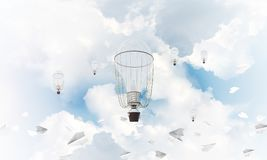 Flying hot air balloons in the air. Colorful aerostats flying among paper planes and over the blue cloudy sky. 3D rendering Royalty Free Stock Images
