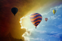 Flying hot air balloons in stormy sky Stock Image