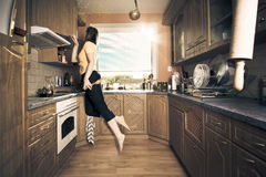 Flying housewife Royalty Free Stock Photo