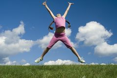 Flying I. The nice girl jumping on  the grass Royalty Free Stock Photo