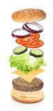 Flying ingredients of hamburger isolated Stock Photos