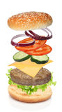 Flying ingredients of hamburger isolated Stock Images
