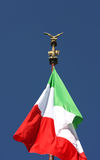 Flying italian flag and bronze eagle, Rome, Italy. Italian flag, flying in the wind, near the National Monument in the capital of Italy, Rome Royalty Free Stock Image