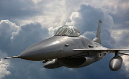 Flying jet aircraft on mission stock image