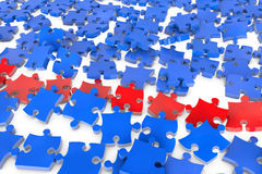 Flying jigsaw puzzle pieces. Many flying jigsaw puzzle pieces in 3D in red and blue Stock Photography