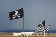 Flying the Jolly Roger. The piratical symbol of skull and crossbones, known as the Jolly Roger Stock Image