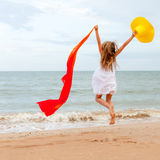 Flying jump beach girl on blue sea shore Stock Photography