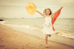 Flying jump beach girl on blue sea shore. Flying jumping beach girl at blue sea shore in summer vacation at the day time Stock Images
