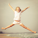 Flying jump beach girl on blue sea shore Royalty Free Stock Photography