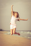 Flying jump beach girl on blue sea shore Royalty Free Stock Photo