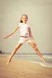 Flying jump beach girl on blue sea shore Royalty Free Stock Image