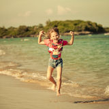 Flying jumping beach girl at blue sea shore Royalty Free Stock Photography