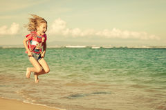 Flying jumping beach girl at blue sea shore Royalty Free Stock Images