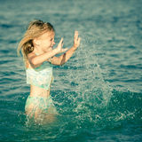 Flying jumping beach girl at blue sea shore Stock Photo