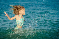 Flying jumping beach girl at blue sea shore Royalty Free Stock Photos