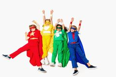 Flying kids in superhero costumes. Isolated on white Royalty Free Stock Photos
