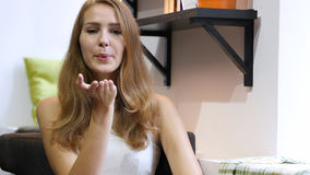 Flying Kiss by Cute Beautiful Girl, Sitting in Love Royalty Free Stock Image