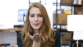Flying Kiss by Girl in Love At Work, Office Employee Stock Photo