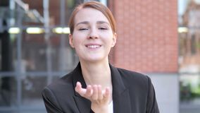 Flying Kiss by Young Businessman Standing Outdoor. 4k high quality, 4k high quality stock footage