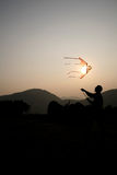 Flying kite. Man flying kite with the sunset Stock Images