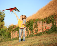 Flying a kite. Happy family flying a kite royalty free stock photo