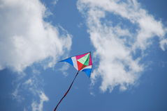 Flying kite 2. Flying kite over a cloudy blue sky Stock Photography