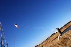 Flying a Kite. Man flying a kite royalty free stock photos