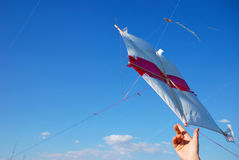 Flying kite. A flying kite and hand Stock Images