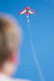 Flying a kite. Man flying a rainbow colored kite, selective focus Stock Images