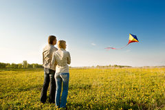Flying a kite. Happy young couple in love flying a kite Royalty Free Stock Images