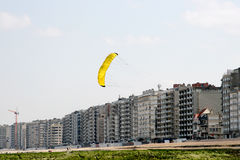 Flying a kite along the coast. Flying a kite on the beach along the North Sea Coast in Belgium Stock Photography