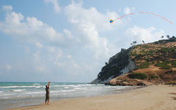 Flying a Kite on a Beach Royalty Free Stock Photos