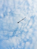 Flying Kite in the blue sky, blue sky and clouds, children` kite silhouette Royalty Free Stock Photos