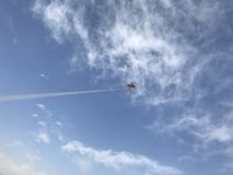 Flying a kite in the blue sky. White clouds Stock Photography