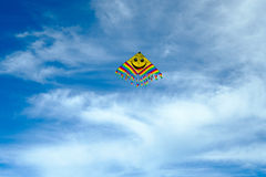 Flying kite in the blue sky Stock Images