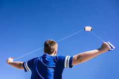 Flying Kite. Child flying a kite in the clear blue sky Royalty Free Stock Photo