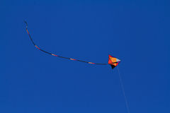 Flying Kite with Tail High Royalty Free Stock Photos