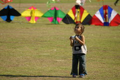 Flying Kites. Young Thai girl flying a kite at Sanaam Luang, Bangkok, Thailand Stock Photography