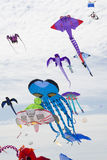 Flying Kites at the Adelaide International Kite Festival. Semaphore, South Australia, Australia - April 15, 2017: A variety of flying figure kites at the Royalty Free Stock Photo