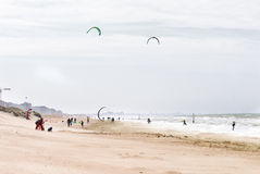 Flying kites on a beach. In autumn on a cold afternoon Stock Images