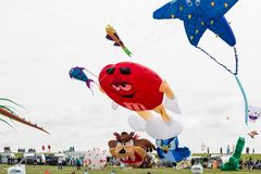 Flying kites. NORDEN-NORDDEICH, GERMANY - MAY 25, 2017: International Kite Festival with numerous flying kites at the beach on May 25, 2017 in Norden-Norddeich Royalty Free Stock Photo