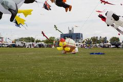 Flying kites. NORDEN-NORDDEICH, GERMANY - MAY 25, 2017: International Kite Festival with numerous flying kites at the beach on May 25, 2017 in Norden-Norddeich Stock Image