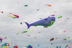 Flying kites. NORDEN-NORDDEICH, GERMANY - MAY 25, 2017: International Kite Festival with numerous flying kites at the beach on May 25, 2017 in Norden-Norddeich Stock Photo