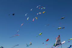 Flying kites. NORDEN-NORDDEICH, GERMANY - MAY 26, 2017: International Kite Festival with numerous flying kites at the beach on May 26, 2017 in Norden-Norddeich Stock Images